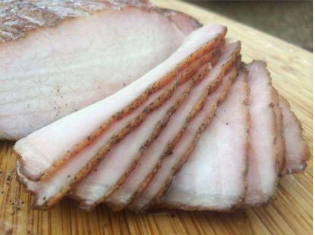 Sliced pork chop smoked on a Weber